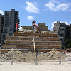 Revere, Ma. 7-16-17. Artis from all over the world work on the main sculpture on Revere Beach beore working on thier own sculptures later this week.