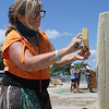 Revere, Ma. 7-16-17. Deborah Barrett-Cutulle, a Saugus resident, works on the main sculpture on Revere <br /> Beach. She will also participate in the individual competition as well.