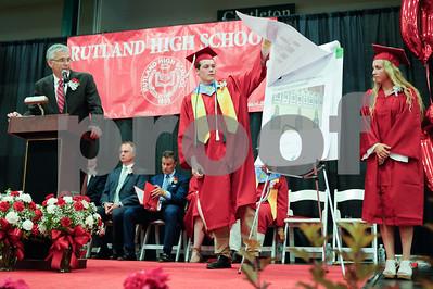 Robert Layman / Staff Photo Bill Olsen, left, Rutland High School Principal, goes through  printed tweets that memorable moments during the class of 2017 school year.