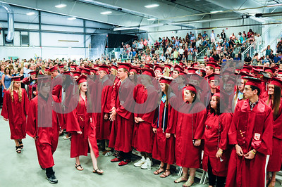 Robert Layman / Staff Photo Graduates from the Rutland High School class of 2017 enter the packed Spartan Stadium during their graduation ceremony Thursday night.