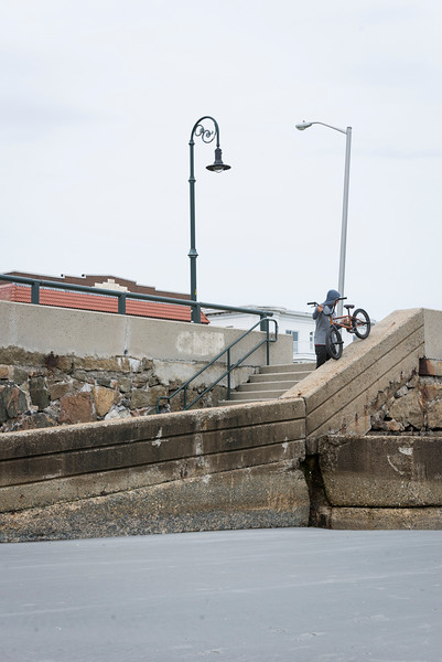 Lynn native Ryan Jordan prepares to do a ledge ride down a ramp onto Lynn Beach.