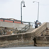 Lynn native Ryan Jordan prepares to do a ledge ride down a ramp onto Lynn Beach.