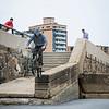Lynn native Ryan Jordan does a ledge ride as he jumps from Lynn Shore Drive onto Lynn Beach.