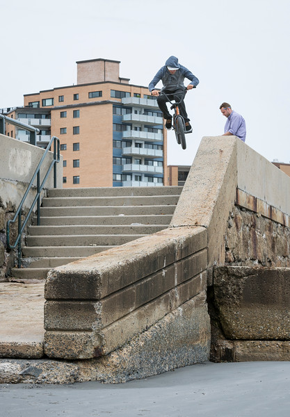 Lynn native Ryan Jordan does a ledge ride as he jumps from Lynn Shore Drive onto Lynn Beach.