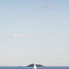 A boat sails past Egg Rock off the coast of Lynn Shore Drive on Friday evening.