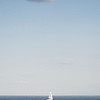 A boat sails off the coast of Lynn Shore Drive on Friday evening.
