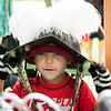 Dante Miller, 3, of Saugus tries on a replica helmet from the 1630s when the Salem Trayned Band visited Saugus Iron Works on Wednesday.