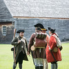 Members of the Lexington Minute Men gather in a field at Saugus Iron Works before their demonstration on Wednesday.