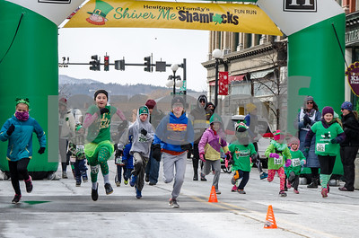 Robert Layman / Staff Photo Runners in the kids race take off during the beginning of the Shiver Me Shamrocks 5k in a frigid downtown Rutland Saturday afternoon.