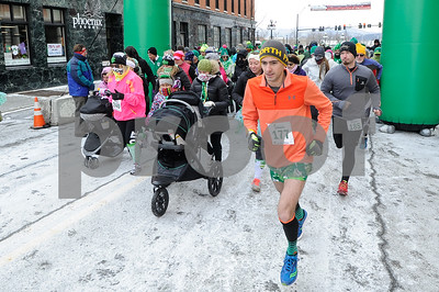 Robert Layman / Staff Photo Sporting nothing but a fleece longsleeve and shamrock imprinted shorts, Jason Linendoll, front right,  takes off into the 10 degree weather during the Shiver Me Shamrocks 5k. Linendoll went to win first place in the 4th annual race with a time just over 18 minutes.