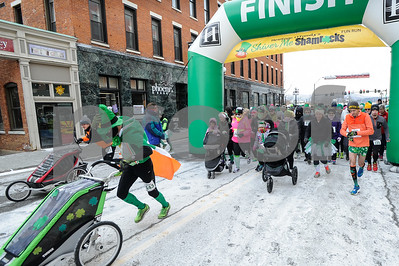 Robert Layman / Staff Photo Racers take off at the Shiver Me Shamrocks 5k race Saturday morning.