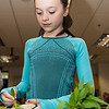Cameron Munion, 9, adds some freshly picked greens from the Summer Street School garden to her salad.
