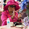 Mattie Valeria claps and sings along to the music during the tea time event at Greater Bethlehem Temple Pentecostal Church in Lynn on Saturday.
