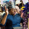 Rev. Annie Belmer from the Zion Baptist Church in Lynn sings along with the music during the tea time event at Greater Bethlehem Temple Pentecostal Church in Lynn on Saturday.