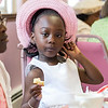 Emelia Wallace, 4, of Lynn enjoys a snack during the tea time event at Greater Bethlehem Temple Pentecostal Church in Lynn on Saturday.