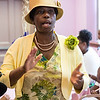 Bertha Burris of Lynn claps and sings along to the music during the tea time event at Greater Bethlehem Temple Pentecostal Church in Lynn on Saturday.