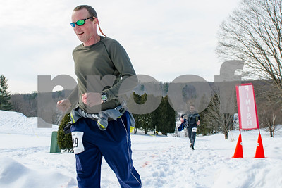 David Walstrom, who placed first, competes in the Frost Feet 5K at Rutland Country Club Monday morning. In addition to encouraging community fitness, the event also raised awareness for Autism awareness and contributed proceeds to Silver Towers Charities, Inc. (Robert Layman / Staff Photo)