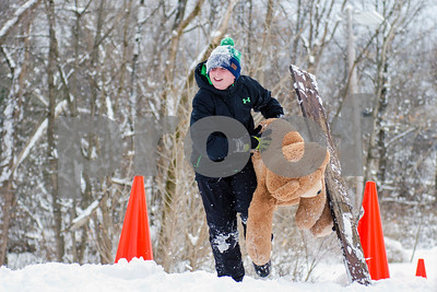 Will Fuller, 12, competes in the Teddy Bear Carry Sunday morning at Giorgetti Park during Rutland's Winterfest Feb 18, 2018. (Robert Layman / Staff Photo)