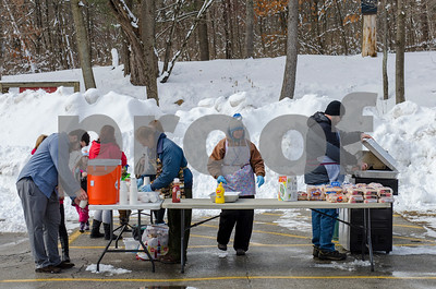 "Refreshments are served to keep the community at Giorgetti Arena during Winter Fest's ""Go Play Day at Giorgetti"" Sunday morning. (Robert Layman / Staff Photo)"