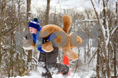 Finn Fuller, 8, competes in the Teddy Bear Carry Sunday morning at Giorgetti Park during Rutland's Winterfest Feb 18, 2018. (Robert Layman / Staff Photo)