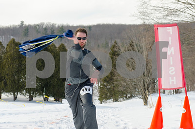 Chris Littler, who placed second, drops a layer with some enthusiasm as he competes in the Frost Feet 5K at Rutland Country Club Monday morning. In addition to encouraging community fitness, the event also raised awareness for Autism awareness and contributed proceeds to Silver Towers Charities, Inc. (Robert Layman / Staff Photo)