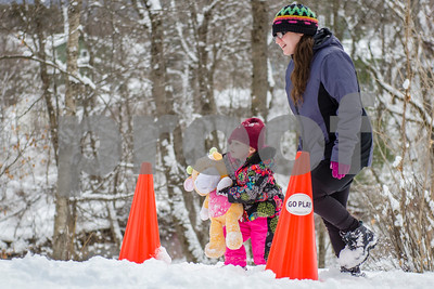 A young competitor runs the track during in the Teddy Bear Carry Sunday morning at Giorgetti Park during Rutland's Winterfest Feb 18, 2018. (Robert Layman / Staff Photo)