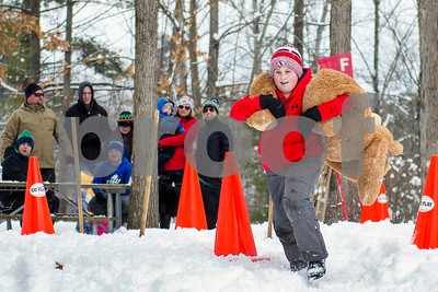 Wyatt Fuller competes in the Teddy Bear Carry Sunday morning at Giorgetti Park during Rutland's Winterfest Feb 18, 2018. (Robert Layman / Staff Photo)