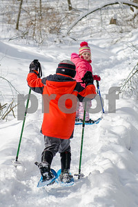 "Kaileigh Cannucci, 4, of Rutland, and her brother, Brayden, wait for their mother before trekking into the wilderness of Pine Hill park during Winter Fest's ""Go Play Day at Giorgetti"" Sunday morning. The Rutland City Recreation Department sponsored event had free snowshoeing rentals for kids and adults. (Robert Layman / Staff Photo)"
