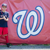 Ryan Fila stands next to the Wyoma logo at Reinfuss Field; the home field of his Wyoma Red Sox Little League team.