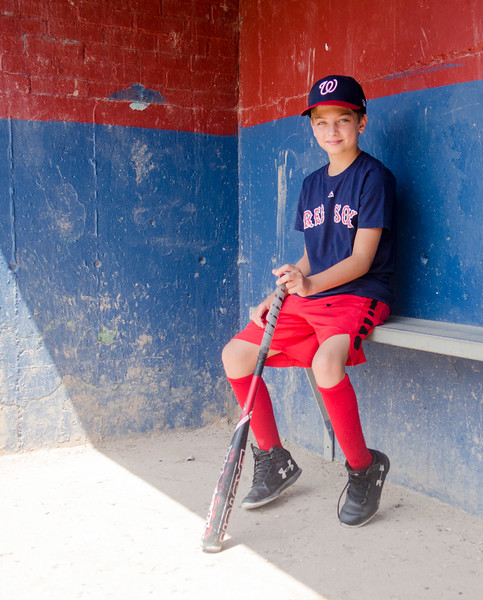 Ryan Fila sits on the bench at Reinfuss Field; the home field of his Wyoma Red Sox Little League team.