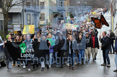 Jeb Wallace-Brodeur / Staff Photo More than 1,500 Vermont students march down East State St., Wednesday on their way to the State House for the Vermont Youth Lobby Rally to Save the Planet.