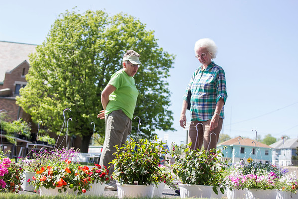 Darla Jackson and Ruth Seim inspect hanging baskets at a flower sale fundraiser for the Heartland Human Society last week. The funds raised from the sales will help pay for shelter animals medical expenses and will also help fund the Pedaling for Pets event in June.