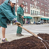 Sue Smith and James Harville spread mulch on a garden bed Tuesday afternoon at the intersection of Courth Street and 2nd East Street. Smith has worked for Downtown Maintenance for 17 years while this is Harville's first season.