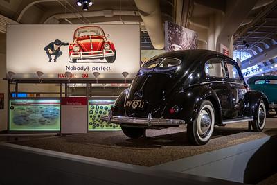 VW Advertising Billboard and 1949 Volkswagen Sedan