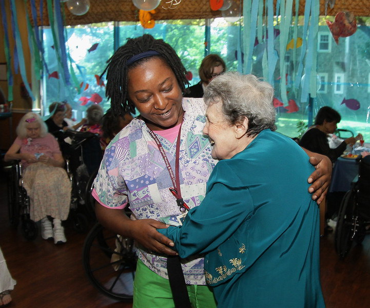 "Mary Little, left, gets resident Natalie Barron onto the dance floor during the first ""Senior Prom"" June 19, 2015 at Edgehill Nursing and Rehabilitation Center, Glenside. <br /> Bob Raines--Montgomery Media"