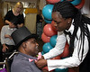 "Staff member Khady Smith dresses up resident George Weems in a top hat, a pink bow tie and a pink carnation for Edgehill Nursing and Rehabilitation Center's first ""Senior Prom"" June 19, 2015.<br /> Bob Raines--Montgomery Media"