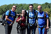 Before their 1st jump, Maggie Devlin and her son Eric took a picture with two Pennridge Regional Airport skydiving specialists. Photo by Debby High
