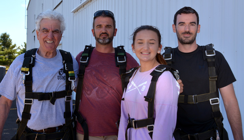 Pete Jusito, 80 yr, son Scott, granddaughter Amber and son Geoffrey skydive together for the 1st time at Pennridge Regional Airport. Photo by Debby High