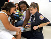 Capt. Joelle Lesniak, Centre Square Fire Co., shows her digital pager to  Brianna Karlson, left, and Madyson Blassingale during the annual Shady Grove Elementary School Heroes Luncheon for first responders on Friday Sept. 12, 2014.<br /> Montgomery Media staff photo by Bob Raines