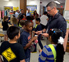 Whitpain Detective Thomas Wittig hands out autographed business cards to fifth-graders during the annual Shady Grove Elementary School Heroes Luncheon for first responders on Friday Sept. 12, 2014.<br /> Montgomery Media staff photo by Bob Raines