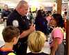 Whitpain Police Officer Brian Wilfong autographs one of his business cards for Danielle Crimmins during the annual Shady Grove Elementary School Heroes Luncheon for first responders on Friday Sept. 12, 2014.<br /> Montgomery Media staff photo by Bob Raines