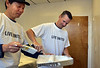 Merck employees Yuxing Li, left, and Jim Hershey work together painting Wednesday  at the Valley Center in Lansdale. The North Penn United Way Day of Caring .   Wednesday, September 17, 2014.  photo by Geoff Patton