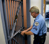 Springfield Township Police Officer Cpl. John Gross closes a cell at the Springfield Administrative Building on Thursday August 7,2014. Photo by Mark C Psoras/The Reporter