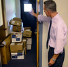 Springfield Township Assistant Manager points out some of the overcrowding at the Springfield Administrative Building on Thursday August 7,2014. Photo by Mark C Psoras/The Reporter
