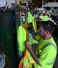 Springfield Township Public Works employees Joe Melon Jr. (Front) and Ed Brower get gear from their lockers located in the garages at the Springfield Municipal campus on Thursday August 7,2014. Photo by Mark C Psoras/The Reporter