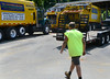 A Springfield Township Public Works employee walks to a truck in the crowded Springfield Municipal campus on Thursday August 7,2014. Photo by Mark C Psoras/The Reporter