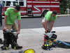 Wissahickon Fire Company firefighter campers Joe Gordon and Jeff Gold race to see who can put on their protective gear first during the last day of camp July 29. Montgomery Media staff photo / ERIC DEVLIN