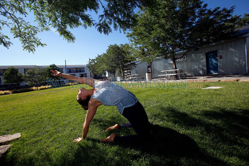 Ashley Rowe of Santa Fe does her Natural Movement workout in the shade at the Railyard Park on Tuesday June 26, 2018. The temperature is forecasted to remain in the 90s for the rest of the week. Luis Sánchez Saturno/The New Mexican