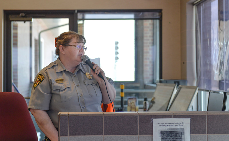 Justin Sheely | The Sheridan Press<br /> Level Three Inspector Dawn Trautman speaks to a driver at the Wyoming Port of Entry north of Sheridan Wednesday, May 9, 2018.