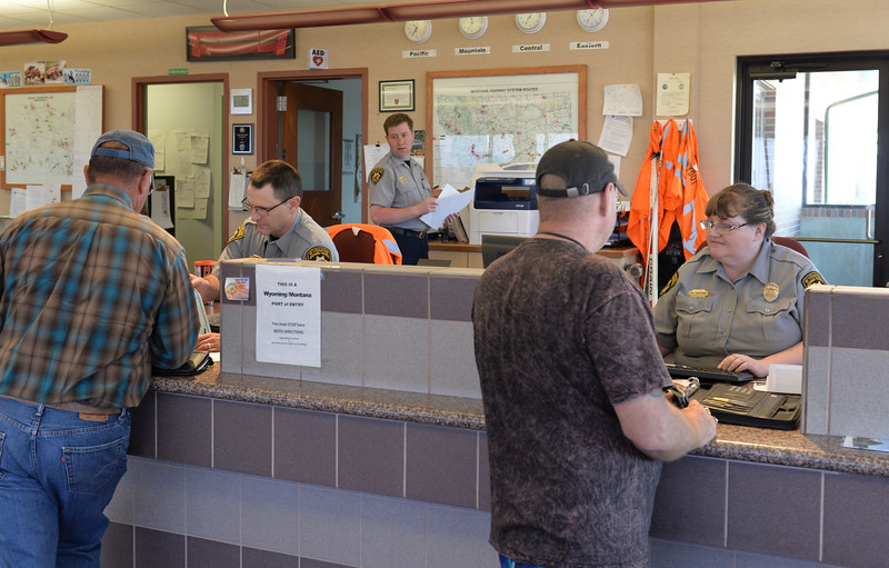 Justin Sheely | The Sheridan Press<br /> Officers, from left, Troy Tyree, Andy Harkins and Dawn Trautman check documents from truck drivers at the Wyoming Port of Entry north of Sheridan Wednesday, May 9, 2018.